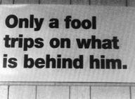 fool trips behind him